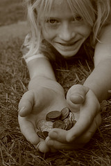 Smiling Child Holding Handful of Pennies Free Creative Commons by Pink Sherbet Photography